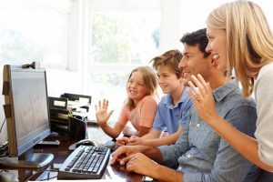 Family using skype in home office